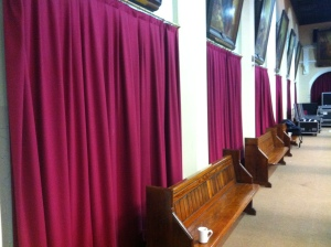 Between each curtain there are two confessionals