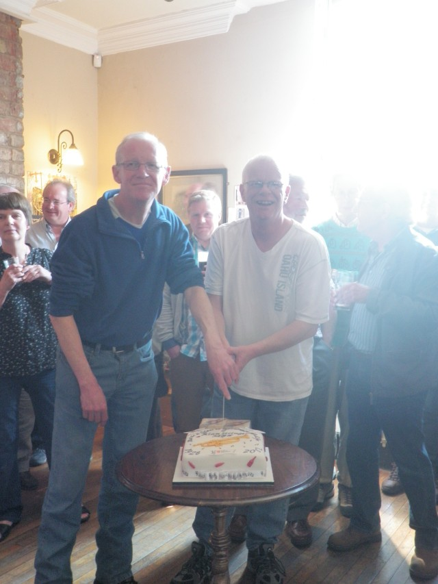 Jim & Malcolm Stringer cut to tribute cake to their father
