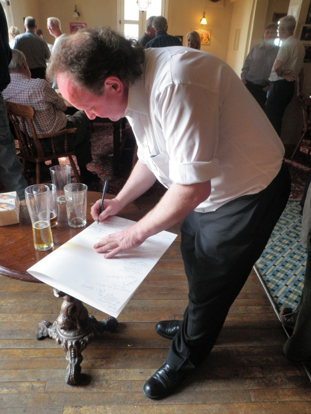 That's me signing the tribute card for Alice Stringer, Alan's widow