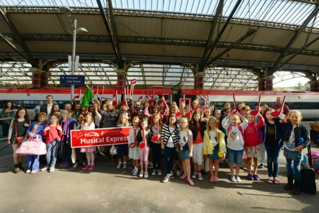 The West Everton Children's Orchestra, The In Harmony team and the combined youth choirs of the Royal Liverpool Philharmonic await to board the Liverpool Philharmonic Muical Express to London to play with the RLPO at the BBC Proms 2013