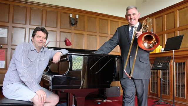 Composer John Spence and Wollongong Conservatorium of Music CEO Andrew Snell say the life of an orchestral musician is challenging. (Justin Huntsdale - ABC)