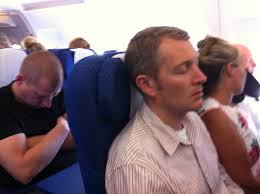 Simon Chappell, RLPO Principal Bass Trombone, resting his eyes on a previous international flight.