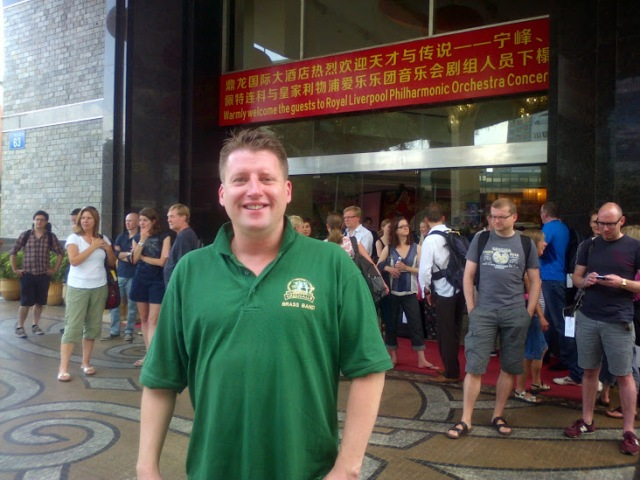 Section  Leader Trombone Simon Cowen awaiting the coach from the hotel to Guangzhou concert hall. Other RLPO members in the background