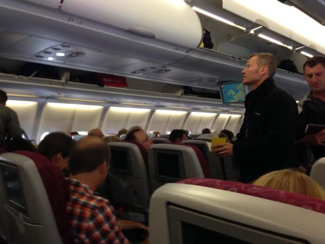 RLPO Bass Trombone Simon Chappell stretching his legs on board the flight