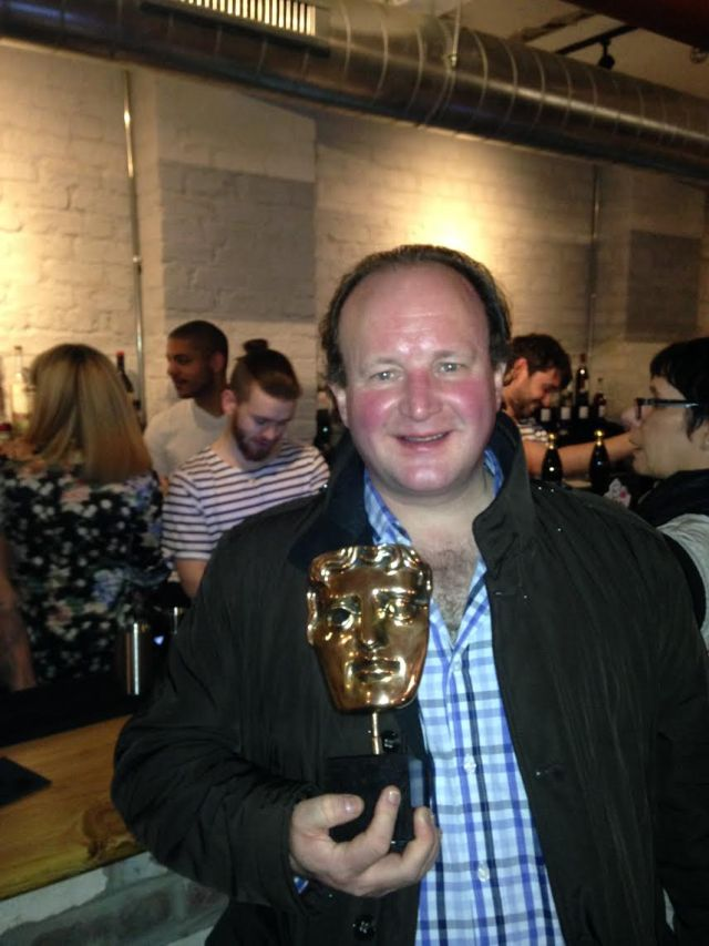 Me posing with someone else's BAFTA Award for poetry!