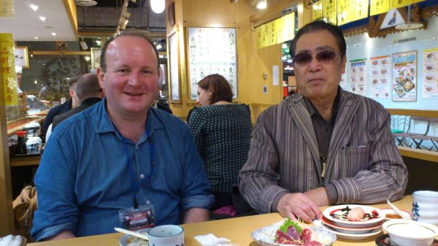 My father-in-law Tadahiro Tanigawa-san and I enjoying some sushi