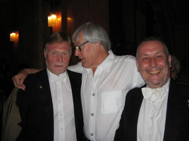 Former RLPO Chief Conductor, Petr Altrichter gives John Hebbron (first violin) and Chris Morley (horn) a big hug after the performance.